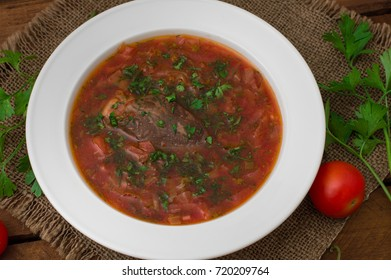 Vegetable borscht. Traditional Ukrainian and Russian soup. Wooden background. Top view. Close-up