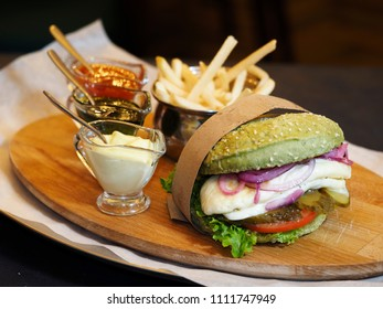 Vegetable Burger. Juicy Chicken Cutlet, Tomato Rings, Mars Onions, Mozzarella, Aioli Sauce, Chips, Salad