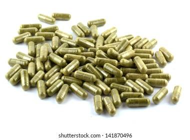 vegetable capsule on white background