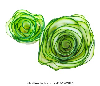 vegetable is carved in form of flowers roses from Japanese cucumber . Food decoration. Vegetable flowers
