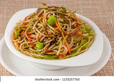 Vegetable Chow Mein a popular oriental dish with noodles and vegetables. This is popular indian-chinese noodles stir fry dish. This is loaded with vegetables and flavored with different sauces.