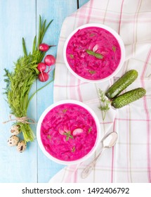 Vegetable cold soup with beetroots and natural yoghurt. Cold borscht - helpful for hot days. Ingredients cold soup: quail eggs, green onion, cucumber, dill, radishes, basil and natural yoghurt.