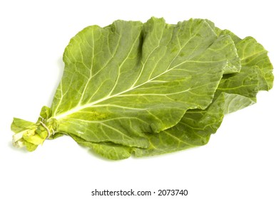 Vegetable collard greens over white background
