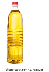 Vegetable cooking oil in a plastic bottle over white background