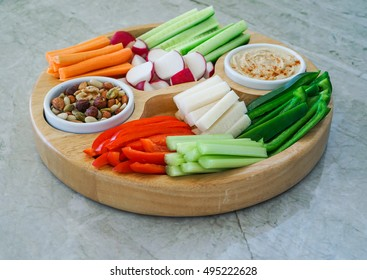 Vegetable Crudites and Dips/ vegetable vegan raw platter with hummus and nuts, healthy eating. Toning. Selective focus