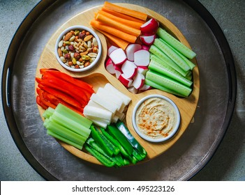 Vegetable Crudites and Dips/ vegetable vegan raw platter with hummus and nuts, healthy eating. Toning.