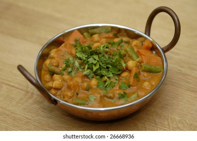 Vegetable curry in a copper dish
