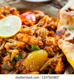 Vegetable Curry -  Indian Cuisine, Sabzi with tomato potato -  Asian cuisine vegetarian or vegan popular dish -  okra, cauliflower, sweet potato, butternut squash, green peas and chilli and coriander.