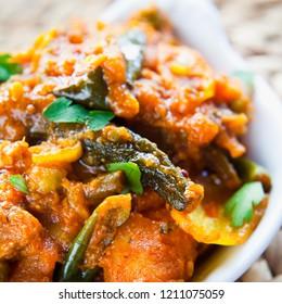 Vegetable Curry -  Indian Cuisine, Sabzi with tomato potato -  Asian Mixed veg or vegan popular dish -  okra, cauliflower, sweet potato, butternut squash, green peas and chilli and coriander.