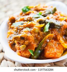 Vegetable Curry -  Mixed Veg curry - -  Asian cuisine vegetarian or vegan popular dish -  tomato, potato, okra, cauliflower, sweet potato, butternut squash, green peas and chilli peppers.