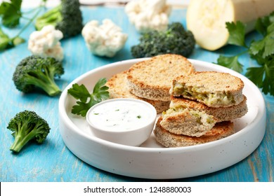 vegetable cutlets and sauce in a white bowl, cauliflower, broccoli on a wooden background