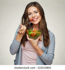 vegetable diet with green salad. smiling woman holding glass bowl with healthy food.