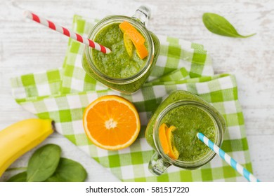 Vegetable and fruit cocktail, served in a jar, with fresh citrus and spinach.