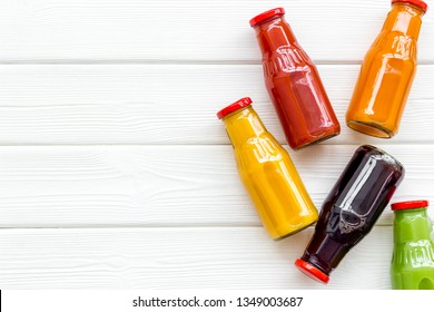 vegetable and fruit juice in bottles for diet drink on white wooden background top view mock up