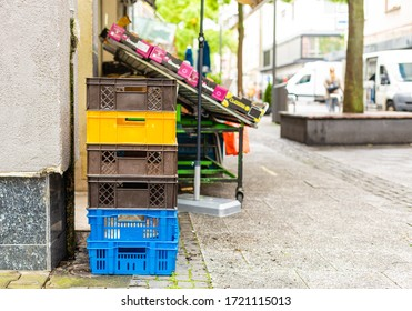 Vegetable and fruit shop. Transport crates. Street exhibition Healthy eating. Shopping in a small store. Delivery of goods.