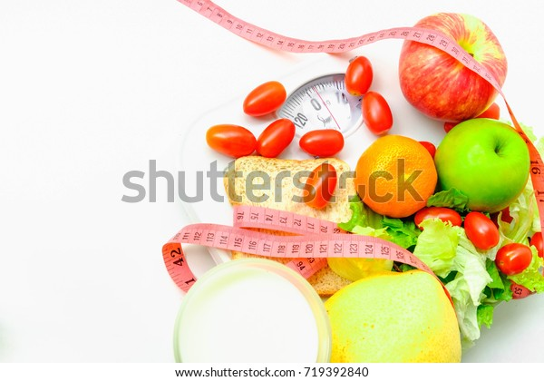 Vegetable and fruits with pink measuring tape on Weight Scale, Concept of health care. Selective focus