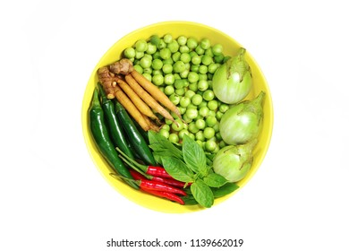 Vegetable Ingredients such as Sweet basil, Pea eggplant or devil's fig, Thai eggplant, Fingerroot, Goat pepper, Bird chilli for used to make Green curry.