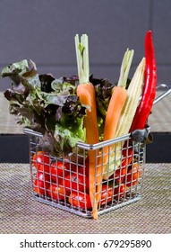 Vegetable in iron basket on the table