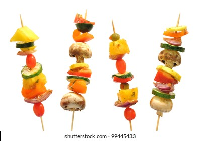 Vegetable kebabs with peppers, mushrooms, zucchini, onions, tomatoes, and pineapple