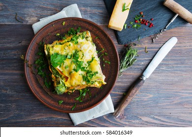 Vegetable lasagne served on ceramic plate - italian cuisine - vegetarian diet. Closeup.