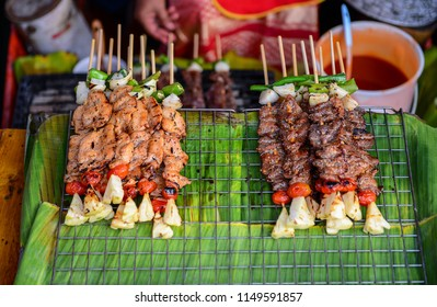 Vegetable and meat skewers at local market