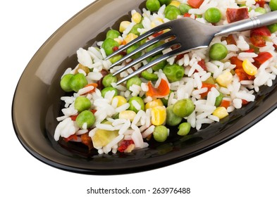 Vegetable mix in dish and fork isolated on white background