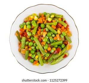 Vegetable mix of green peas, carrot, corn, sweet pepper, green beans in white bowl isolated on white background. Top view