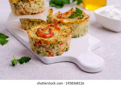 Vegetable muffins with shrimp on a light gray background. Selective focus.