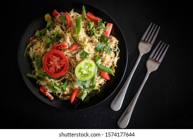 Vegetable Noodles with Tomato (Red & Green), Onion, chile and butter.