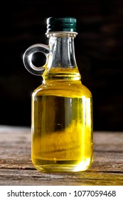 vegetable oil  bottle close-up on wooden background