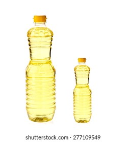 Vegetable oil for cooking in a bottle isolated on white background