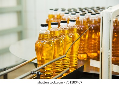 Vegetable oil production plant. Bottling line of vegetable oil in bottles