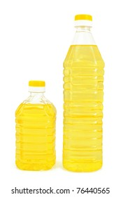 Vegetable oil in two bottles isolated on white background