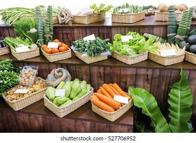 Vegetable on wooden display shelf in grocery supermarket.