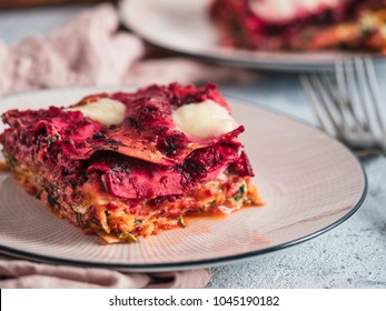 Vegetable Packed Rainbow Lasagne on pink plate. Ideas and recipes for healthy vegetarian dinner or lunch. Lasagne with beetroot, pumpkin, mushrooms, ricotta, spinach, mozarella