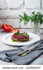 Vegetable Packed Rainbow Lasagne on craft board.Ideas and recipes for healthy vegetarian dinner or lunch. Lasagne with beetroot and parsley