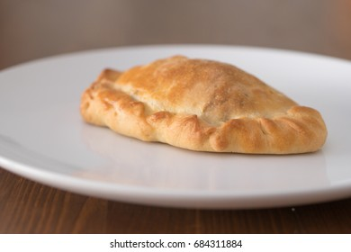 vegetable pasty on a white plate