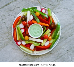 Vegetable Platter Crudites with Cucumber Dill Dip, Healthy Eating Concept, Top View.