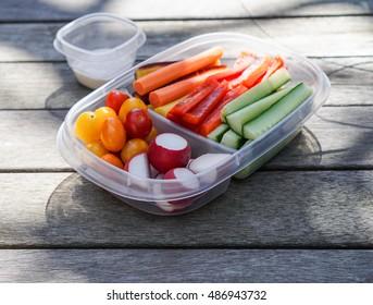 Vegetable platter/ crudités, vegetables in plastic container, healthy eating concept
