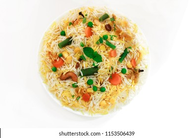Vegetable Pulao / Mixed  Veg Biryani isolated on white Overhead view