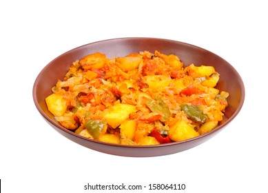Vegetable ragout on bowl isolated on white background