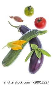 vegetable ratatouille with eggplant, zucchini, tomatoes on white