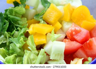 vegetable salad background: cucumber, tomato and celery
