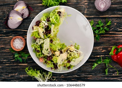 Vegetable salad with beetroot and lettuce. Top view. On a wooden background. Copy space.