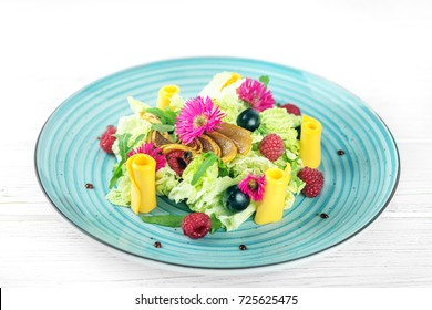 Vegetable salad in a blue plate. The concept is healthy food, diet, vegetarianism.