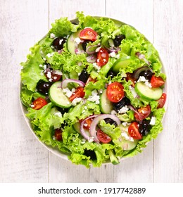 vegetable salad with cucumber, tomato, onion and tomato