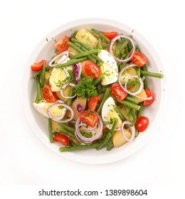 vegetable salad with egg, potato, bean and onion isolated on white background