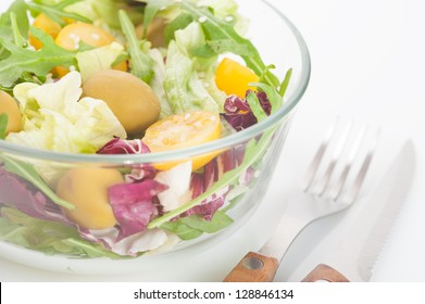 Vegetable salad with fork and knife