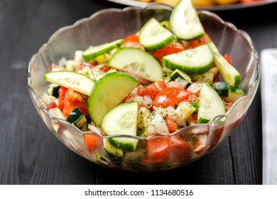 vegetable salad made of tomatoes, cucumbers, onions, zucchini