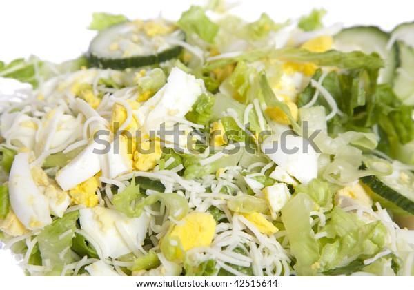 Vegetable salad on white isolated background